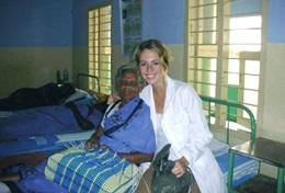 A volunteer nursing student with one of her senior patients in India