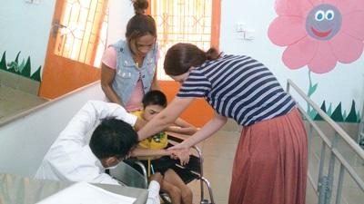 Physical Therapy intern treating a Cambodian child