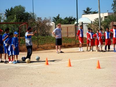 Moroccan children participate in soccer drills at a practice coached by a volunteer