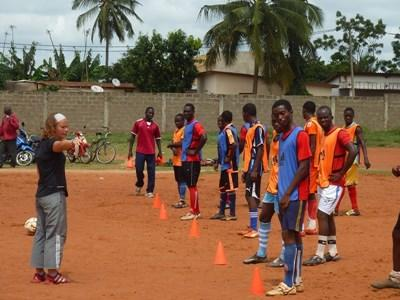 Volunteer football coach leads an after school club in Togo