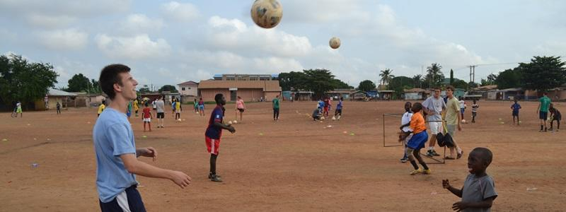 Volunteers coach football at a school abroad on the Sports project