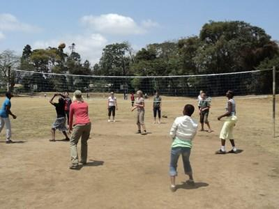 Volunteer coaches volleyball to school children in Tanzania, Africa