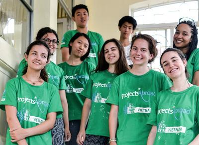 High school students volunteering together at a rehabilitation centre for their customized group trip in Vietnam, Asia