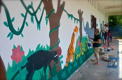 A group of volunteers finishing some murals at Sadae Kindergarten