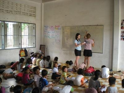 Volunteers teach English at a school in Cambodia