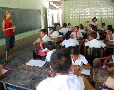 Female volunteer leading a lesson to students in a school in Costa Rica
