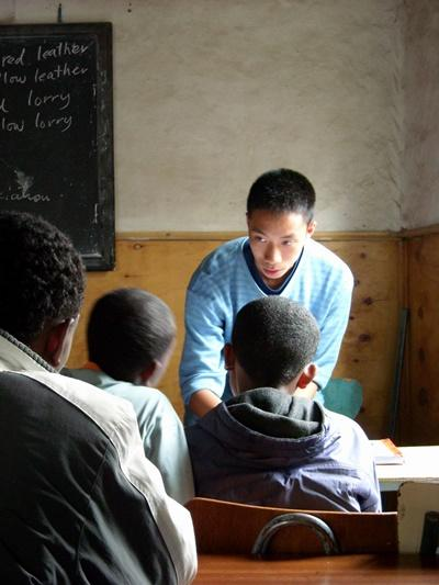 English Teaching volunteer in a lesson with school children in Ethiopia