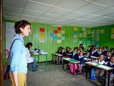 A class of Ethiopian school children meet their volunteer teacher