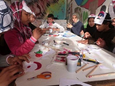 School children in Morocco have fun with a creative exercise planned by a Teaching volunteer.