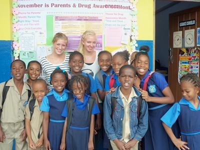 Volunteers with a classroom of students in a school in Jamaica, the Caribbean