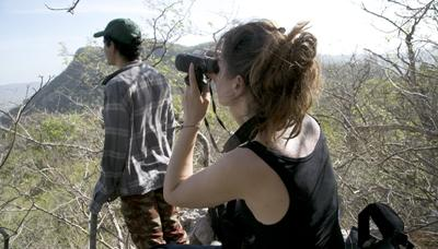 A Projects Abroad Conservation volunteer conducts bird research at Barra Honda National Park in Costa Rica.
