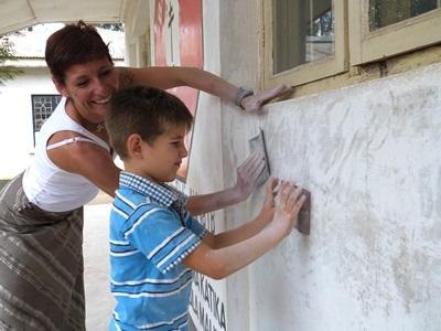 Mother and son work on a building project overseas