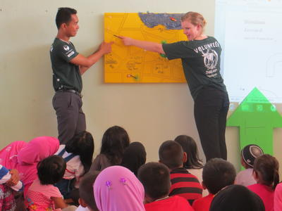 In Thailand a student volunteer abroad teaches a class
