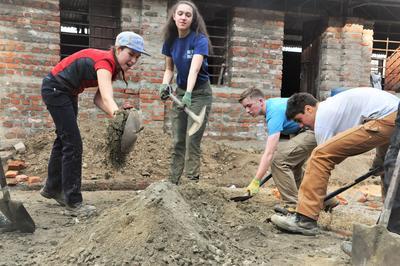 A group builds a school in Nepal as volunteer work overseas
